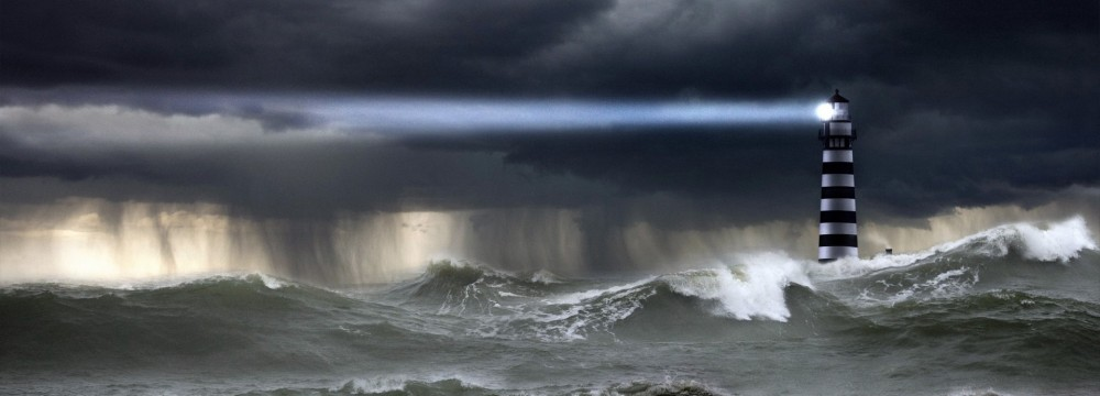 ocean-storm-waves-sky-clouds-rain-shower-lighthouse-beam-light-element-1000x360